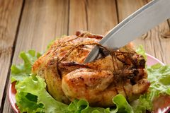 Bondage shibari roasted chicken on wooden background, cutting co Royalty Free Stock Photo