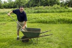 Bonde Mixing Compost Royaltyfria Bilder