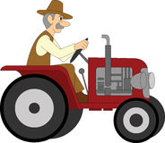 Bonde Riding en traktor Arkivfoto