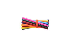 Bonded rubber band markers and pencils. Royalty Free Stock Images