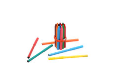 Bonded rubber band markers and pencils. Stock Photos