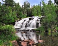 BondFalls, Michigan vattenfall i fjädern, USA Royaltyfri Bild