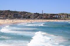 Bondi beach. Scenic view of people on Bondi beach with waves breaking in foreground, Sydney, Australia Royalty Free Stock Photos