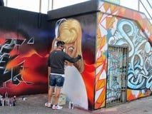 At Bondi Beach artistic graffiti is being painted on the walls on the promenade, NSW, Australia stock image