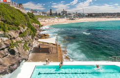 BONDI BEACH, AUSTRALIA - OCTOBER 2015: People relax on the beach Royalty Free Stock Photography