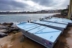 Bondi beach boats. Boats with blue wooden covers at Bondi beach Sydney Australia Stock Images
