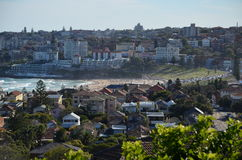 Bondi Beach Suburb. The suburb of Bondi Beach on a hot summer's day, with a crowded Bondi Beach visible between the houses and apartments Stock Photo
