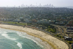 Bondi Beach and Sydney. Aerial view of Sydney's Bondi beach with the city and downtown Skyline beyond Royalty Free Stock Photography