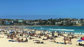 Bondi beach in sydney. Thousands pack Bondi Beach on a hot summer day