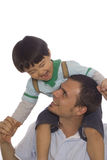 Bonding. Father holding his son on his shoulders royalty free stock photography