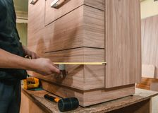 Assembly of furniture. Bonding and assembly of furniture on the wooden pins stock images