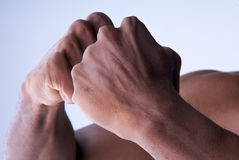 Bonding Hands. Powerful hands bonding together in detail royalty free stock photo