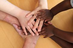 Hands layering and depicting racial harmony.