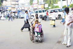 Bonding. Physically challenged daughter is carried by her father. Generally daughter is support to the old father here the opposite takes place Royalty Free Stock Photography