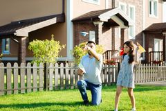 Charming daughter launching paper planes with father stock photography