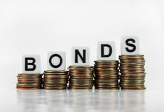 """Bonds – Business Concept. A graph of US quarters with the word """"BONDS"""" isolated on a white background Stock Image"""