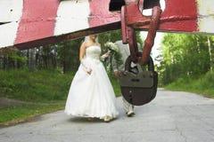 Bonds of matrimony. Big old lock and wedding couple on background Stock Image