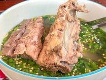 Bone and beef soup in bowl. At thailand stock photography