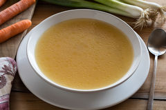 Bone broth made from chicken served in a plate Royalty Free Stock Photo