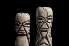 Bone carved African figurines Royalty Free Stock Photo