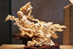 Bone carving of two girls Stock Images