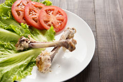 Bone chicken and vegetable on wooden background. Stock Photo