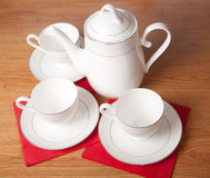 Bone china tea set on a wooden table Royalty Free Stock Photos