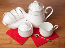 Bone china tea set on a wooden table Stock Image
