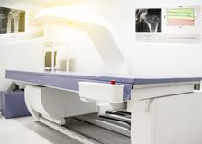 Bone density machine, is in the Xray department of hospital used for diagnose osteoporosis symptoms. Surface blurry inmag stock photography