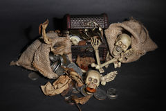 Bone guarding the treasure. Dark and scary things royalty free stock images