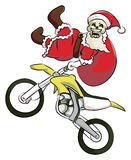 Bone head santa claus extreme motocross. Bone head wearing a Santa Claus costume, riding motocross and doing freestyle Stock Photo