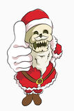 Bone head santa clause. Bone head wear santa claus costume thumb pose from high angle Royalty Free Stock Images