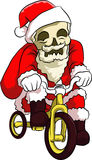 Bone head santa cycling. Bone head wear santa dresses riding a bicycle with smile in his face to celebrate christmas day Royalty Free Stock Photos