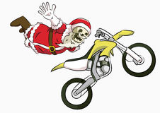 Bone head santa freestyle motocross. Bone head costume santa claus freestyle motocross action with a yellow trail bike Royalty Free Stock Photography