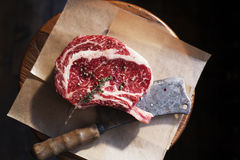 Bone In Rib Eye row Steak and knife Royalty Free Stock Images