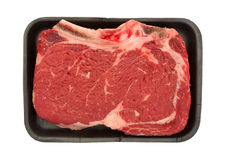 Bone in rib eye steak on black butcher tray Royalty Free Stock Photos