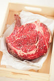 Bone-in Rib eye Steak steak on paper Royalty Free Stock Image