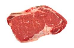 Bone in rib eye steak on a white background Royalty Free Stock Images