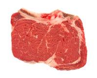 Bone in rib eye steak on a white background Stock Image