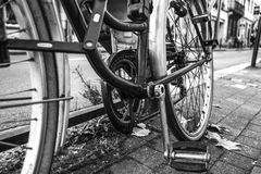 Bone shaker. Old bicycle on the street royalty free stock photos