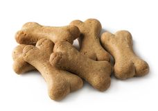 Bone shaped dog biscuit. Isolated on a white background stock photography