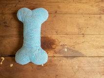 Bone small blue pillow. Placed on the wooden floor royalty free stock photo