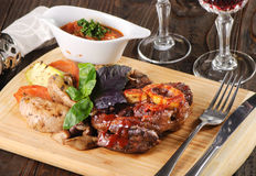 Bone steak with potatoes Royalty Free Stock Images