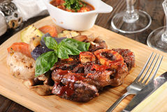 Bone steak with potatoes Royalty Free Stock Image