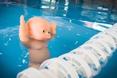 Boneca afogada na associação Imagem de Stock