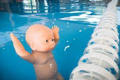 Boneca afogada na associação Imagens de Stock Royalty Free