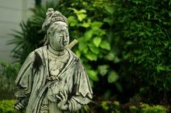 Boneca chinesa de pedra no jardim real Fotos de Stock