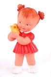 Boneca de borracha com vestido vermelho sobre Fotografia de Stock Royalty Free