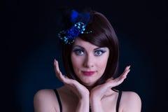 A boneca gosta da mulher com chapéu azul e chicotes longos Fotografia de Stock Royalty Free