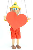 A boneca prende o coração Fotos de Stock Royalty Free